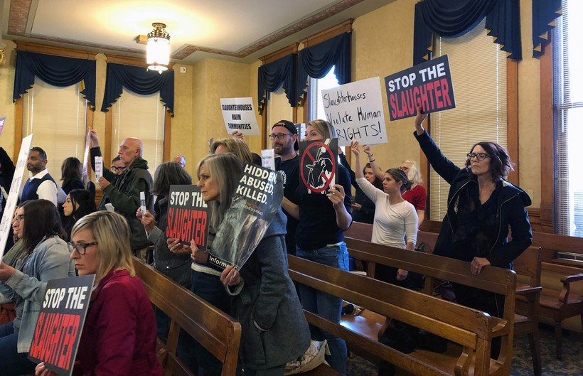 People protesting a slaughterhouse during a Milwaukee Common Council meeting