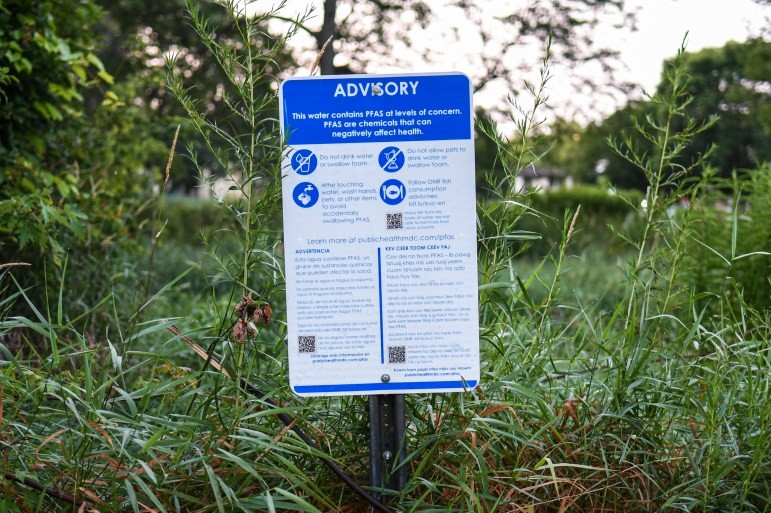 A sign warning of PFAS risks in Starkweather Creek