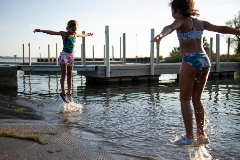 Stoni Hawkins and Terriyah Moss play in Starkweather Creek at the Olbrich Park