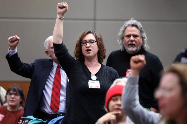 "Mariah Clark, an emergency department nurse, sings ""Solidarity Forever"" during a meeting"