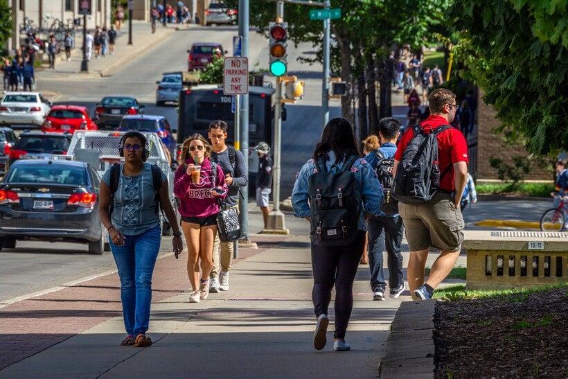 Students walking along Johnson St. on the University of Wisconsin-Madison campus.