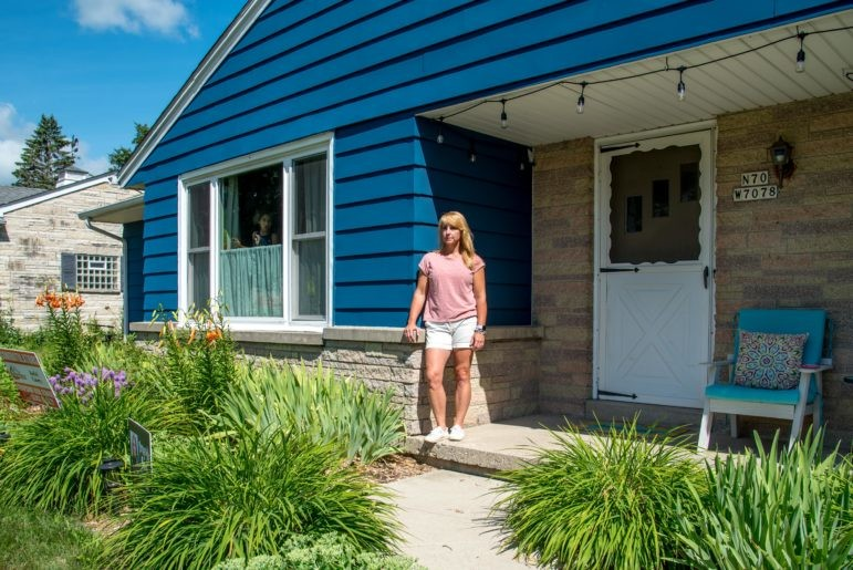 Rykki Casey is seen in front of her home in Cedarburg, Wis