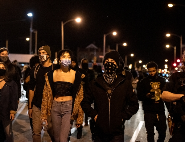 Protesters march in the street at night