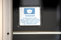 A sign saying face masks are required