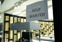 A Help Wanted sign is posted at a Designer Eyes store