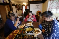 A family celebrates a meal ahead of Thanksgiving