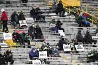 A limited number of fans at Lambeau Field watch a Green Bay Packers game