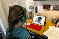 Anne Marie Canlis watches an online lecture for school