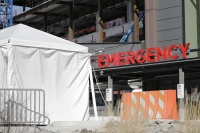 A tent stands at the emergency entrance to Seattle Children's hospital