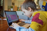 Keith Bucks works at home remotely during an online class assignment from his first grade class