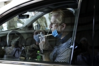 Wayne Taylor gets a free drive-thru COVID-19 test at the testing facility in Waukegan, Ill.