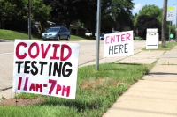 Signs outside a temporary COVID-19 testing site on Madison's northside