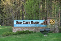 A sign entering the Red Cliff reservation