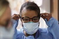 Respiratory therapist wears mask