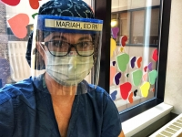 Mariah Clark, an emergency room nurse who has worked at University of Wisconsin Hospital for 12 years, wears personal protective equipment