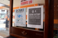 A sign inside a Boost Mobile store on Milwaukee's Atkinson Avenue about housing assistance