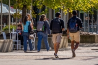 Students walking on East Campus Mall on the University of Wisconsin-Madison campus.
